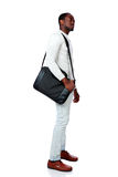 Serious african man standing with bag Stock Photos