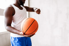 Serious african sportsman finishing to play with ball stock photos