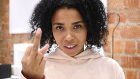 Serious Afro-American woman showing middle finger in anger