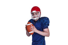 Serious american football player holding a ball Royalty Free Stock Image