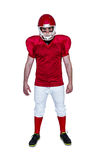 Serious american football player looking at camera Stock Images