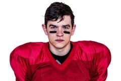 Serious american football player looking at camera Stock Photo