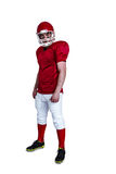 Serious american football player wearing a helmet Stock Images