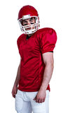 Serious american football player wearing a helmet Stock Photo