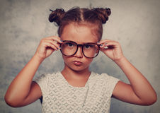 Serious angry kid girl with modern hair style in fashion glasses Royalty Free Stock Photo