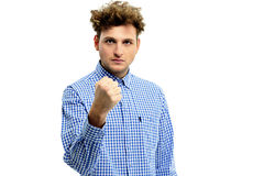 Serious angry man showing fist. Over white background Stock Photos