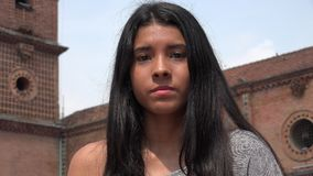 Serious Apathetic Teen. A young hispanic female teen Royalty Free Stock Image