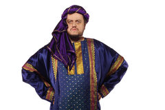 Serious Arabist. A man with an Arabian costume isolated on white background Royalty Free Stock Photos