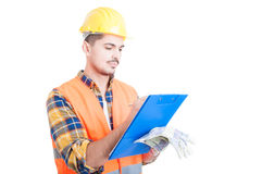 Serious architect or engineer writing on a clipboard Royalty Free Stock Photos