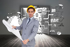 Serious architect with hard hat holding plans Stock Image