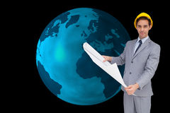 Serious architect with hard hat holding plans Stock Photo