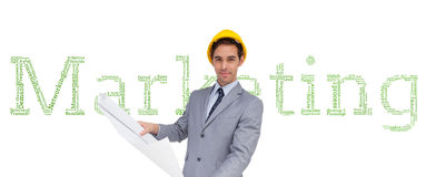 Serious architect with hard hat holding plans Stock Photos