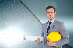 Serious architect holding plans and hard hat Stock Photography