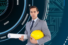 Serious architect holding plans and hard hat Stock Image