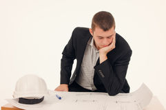 Serious Architect Looking at the Blueprint Stock Photography