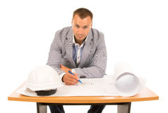 Serious architect working on a blueprint Stock Photography
