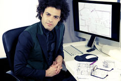 Serious architect working with computer in office looking camera Stock Photography