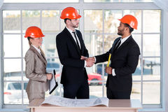 Serious architects shaking hands Stock Image