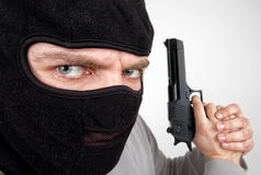 Serious armed criminal with gun Stock Images