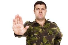 Serious army soldier making stop sign Stock Photo