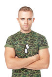 Serious army soldier with military ID tags Royalty Free Stock Images