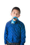 Serious asian boy with necktie in his mouth  on the whit Royalty Free Stock Image