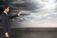 Serious asian businessman pointing Royalty Free Stock Photo