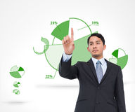 Serious asian businessman pointing Stock Image