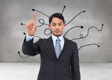 Serious asian businessman pointing Stock Photos