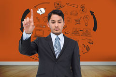 Serious asian businessman pointing Royalty Free Stock Images