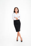 Serious asian businesswoman standing with arms folded and legs crossed Royalty Free Stock Image