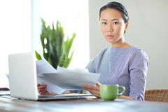 Serious Asian Businesswoman Working in Office Royalty Free Stock Photos
