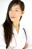 Serious asian female doctor smiling Royalty Free Stock Images