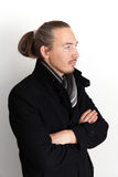 Serious Asian man in black coat and woolen scarf Stock Photo