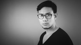Serious Asian man. Black and White photo of serious Asian man in Black T-shirt royalty free stock photos