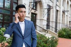 Serious Asian man on the phone Stock Photos
