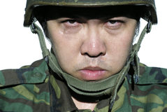 Serious asian soldier Stock Images