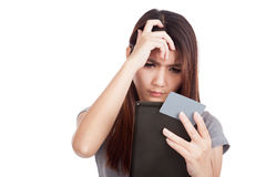 Serious Asian woman with blank card and tablet PC Royalty Free Stock Photo
