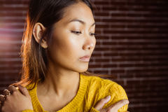 Serious asian woman looking down Royalty Free Stock Photos