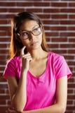 Serious asian woman thinking Royalty Free Stock Photos