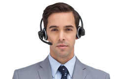 Serious assistant with headset Royalty Free Stock Images