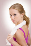 Serious athletic girl. Purposeful serious athletic girl with a towel stock photography
