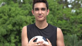 Serious Athletic Male Hispanic Teenager. A handsome hispanic male teen stock footage