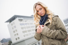 Serious attractive blonde posing outdoors Royalty Free Stock Image