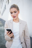 Serious attractive businesswoman sending a text Royalty Free Stock Image