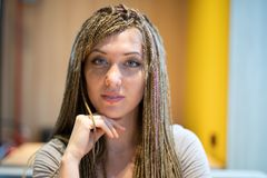 Serious attractive woman with long braided hair royalty free stock photos