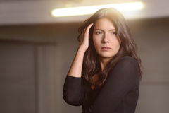 Serious attractive woman staring at the camera Royalty Free Stock Photo