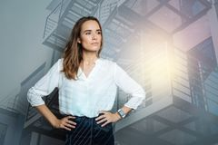 Serious attractive woman thinking about work Stock Photography