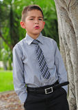 Serious attractive young boy stock images