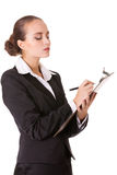 Serious auditor with document. Serious business woman with a clipboard makes notes in document. Isolated on white background Stock Photo